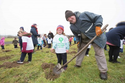 "**NO REPRO FEE** Ella Meehan gets a little help with her tree from Mort Collins at the ""One Tree per Child"" initiative at Active Kilrush Sports Project. Kilrush Tidy Towns, in partnership with local schools and Clare County Council, have embarked on an initiative to ensure every child will plant a tree of their own As part of National Tree Week. Photograph by Eamon Ward"