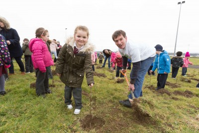 "**NO REPRO FEE** Marissa Ward gets a little help with her tree from Paul Edson, Chairman Kilrush Tidy Towns and friends from local primary schools St. Senan's NS and Gaelsoil Ui Choimin planting their trees as part of the ""One Tree per Child"" initiative at Active Kilrush Sports Project. Kilrush Tidy Towns, in partnership with local schools and Clare County Council, have embarked on an initiative to ensure every child will plant a tree of their own As part of National Tree Week. Photograph by Eamon Ward"