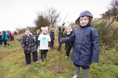 "**NO REPRO FEE** Emma Lynch and friends from local primary schools St. Senan's NS and Gaelsoil Ui Choimin planting their trees as part of the ""One Tree per Child"" initiative at Active Kilrush Sports Project. Kilrush Tidy Towns, in partnership with local schools and Clare County Council, have embarked on an initiative to ensure every child will plant a tree of their own As part of National Tree Week. Photograph by Eamon Ward"